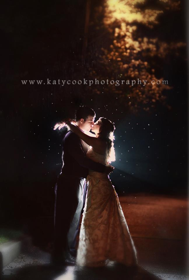 The perfect kiss captured in the rain.